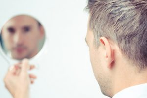43277081 - ego business man looking in the mirror and reflecting